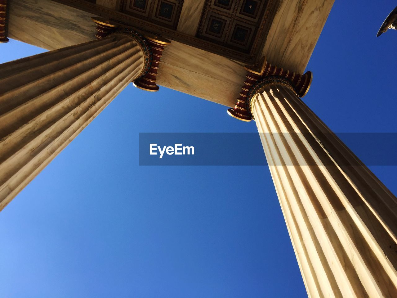 Academy Of Athens Columns Against Clear Blue Sky