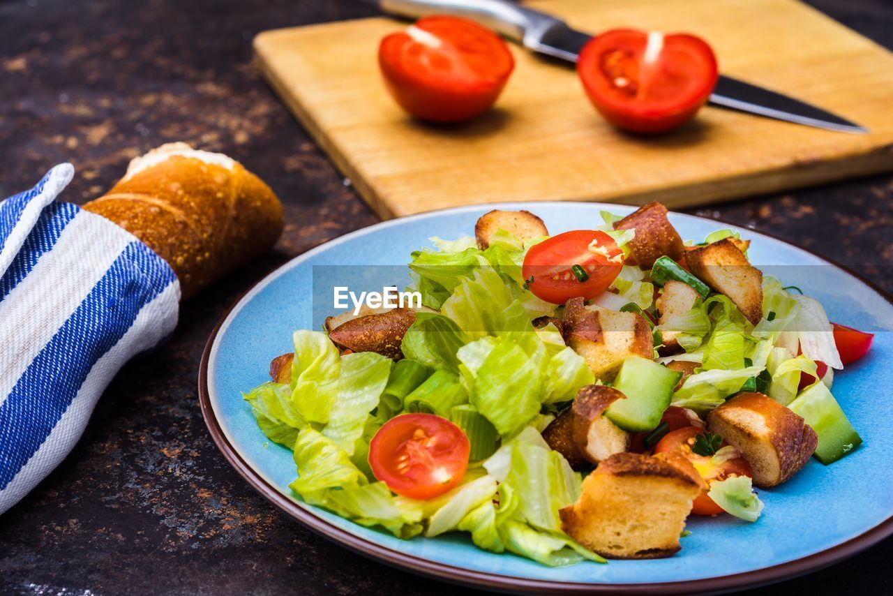 food, food and drink, vegetable, freshness, healthy eating, tomato, wellbeing, fruit, plate, table, ready-to-eat, indoors, still life, close-up, no people, cherry tomato, salad, meal, serving size, lettuce, snack, crockery, nacho chip