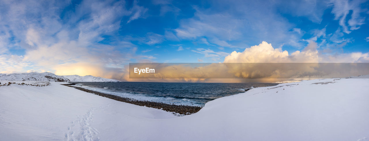 Barents Sea Winter Panorama near the Russian fishing village of Teriberka in the Kola Peninsula, above the Arctic circle. Stitching of 9 pictures to create a 16.000 x 6.000 pixel image Panorama Winter Nature Beauty In Nature Sea Barents Sea Teriberka Murmansk Region Kola No People Copy Space Breathtaking Environment Pristine Nature Unspoiled Nature Arctic Polar Region Cold Temperature Snow Footprints In The Snow