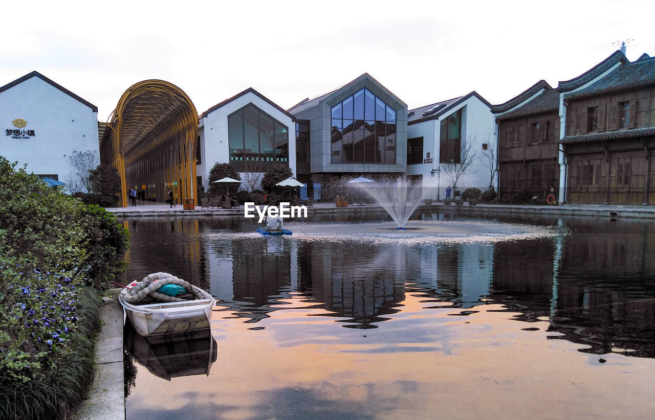 water, building exterior, built structure, architecture, reflection, building, lake, waterfront, nature, sky, no people, day, residential district, house, tree, outdoors, city, travel destinations