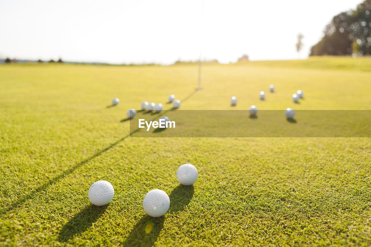 Close-Up Of Golf Balls On Grass