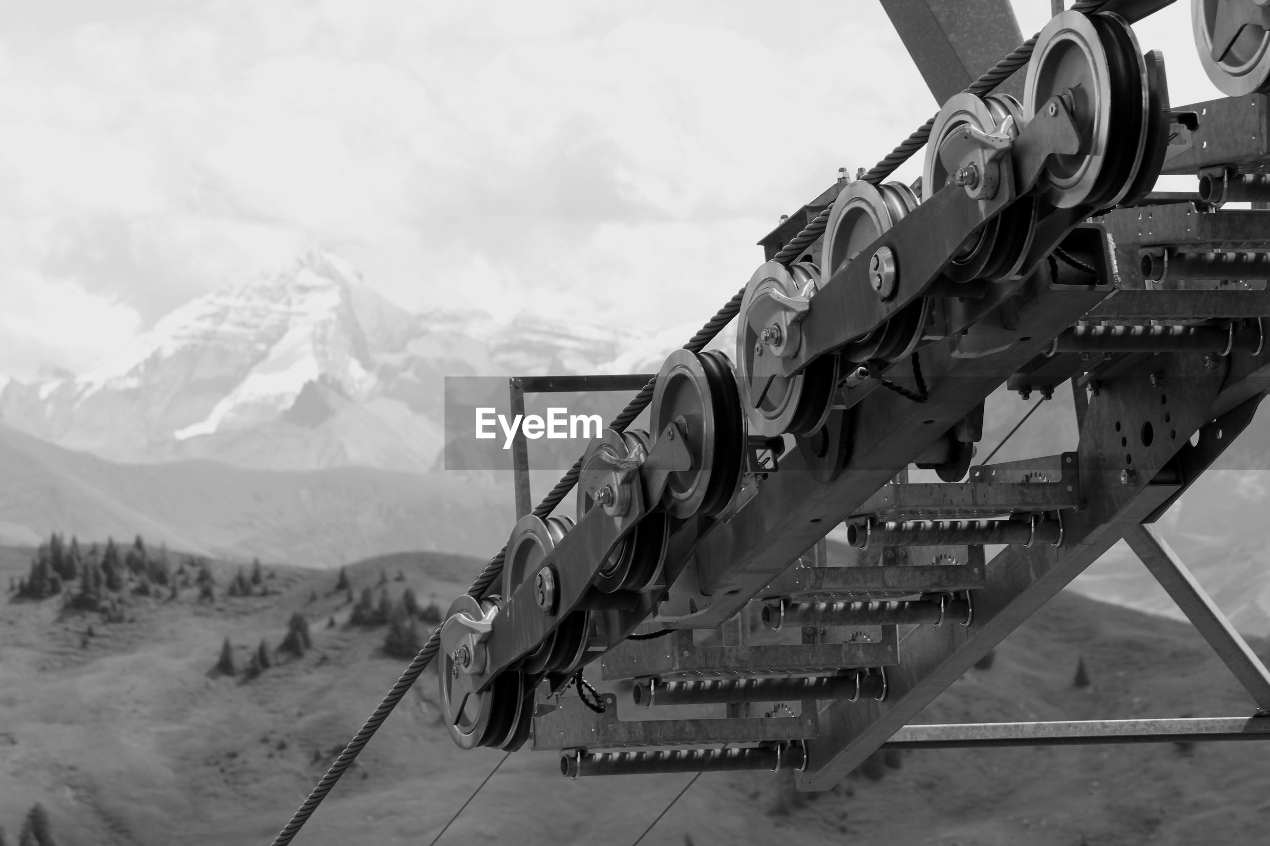 Close-up of machine part against sky