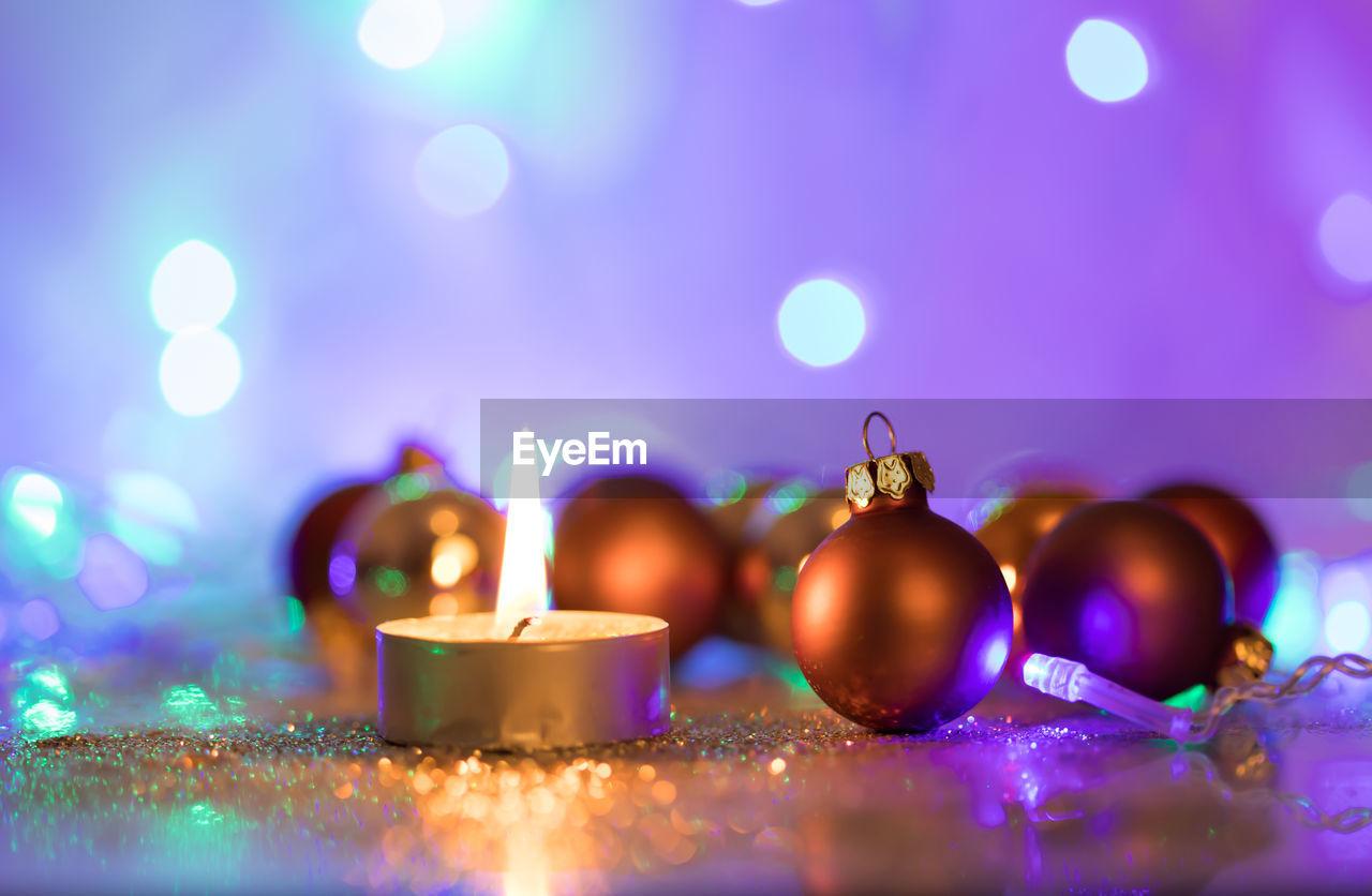 illuminated, glowing, selective focus, no people, close-up, decoration, celebration, lens flare, indoors, light - natural phenomenon, lighting equipment, christmas decoration, night, event, shape, christmas, focus on foreground, christmas lights, celebration event, christmas ornament, light