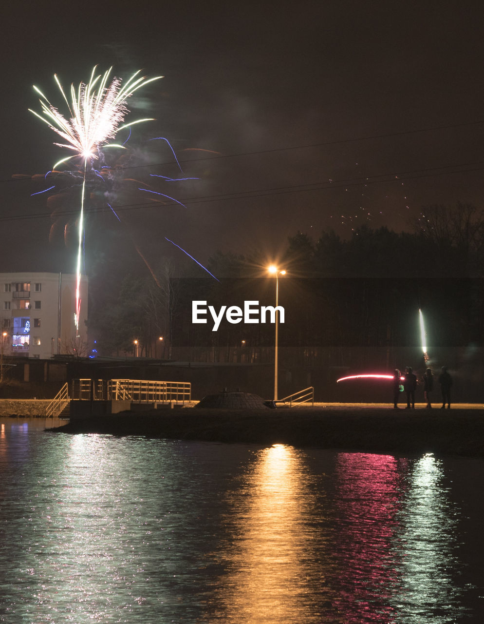 illuminated, night, water, firework, arts culture and entertainment, waterfront, sky, river, motion, reflection, long exposure, glowing, celebration, event, architecture, no people, exploding, transportation, firework display, firework - man made object, light, outdoors, sparks