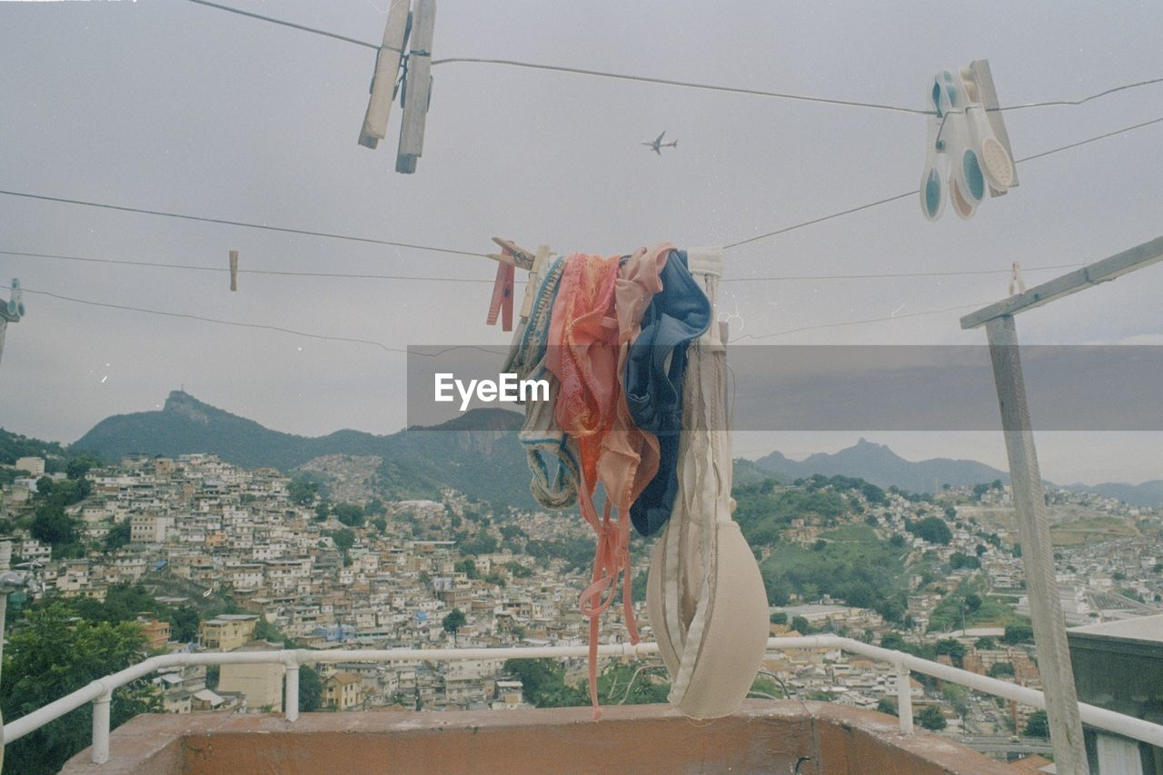 Cloths drying in balcony against clear sky