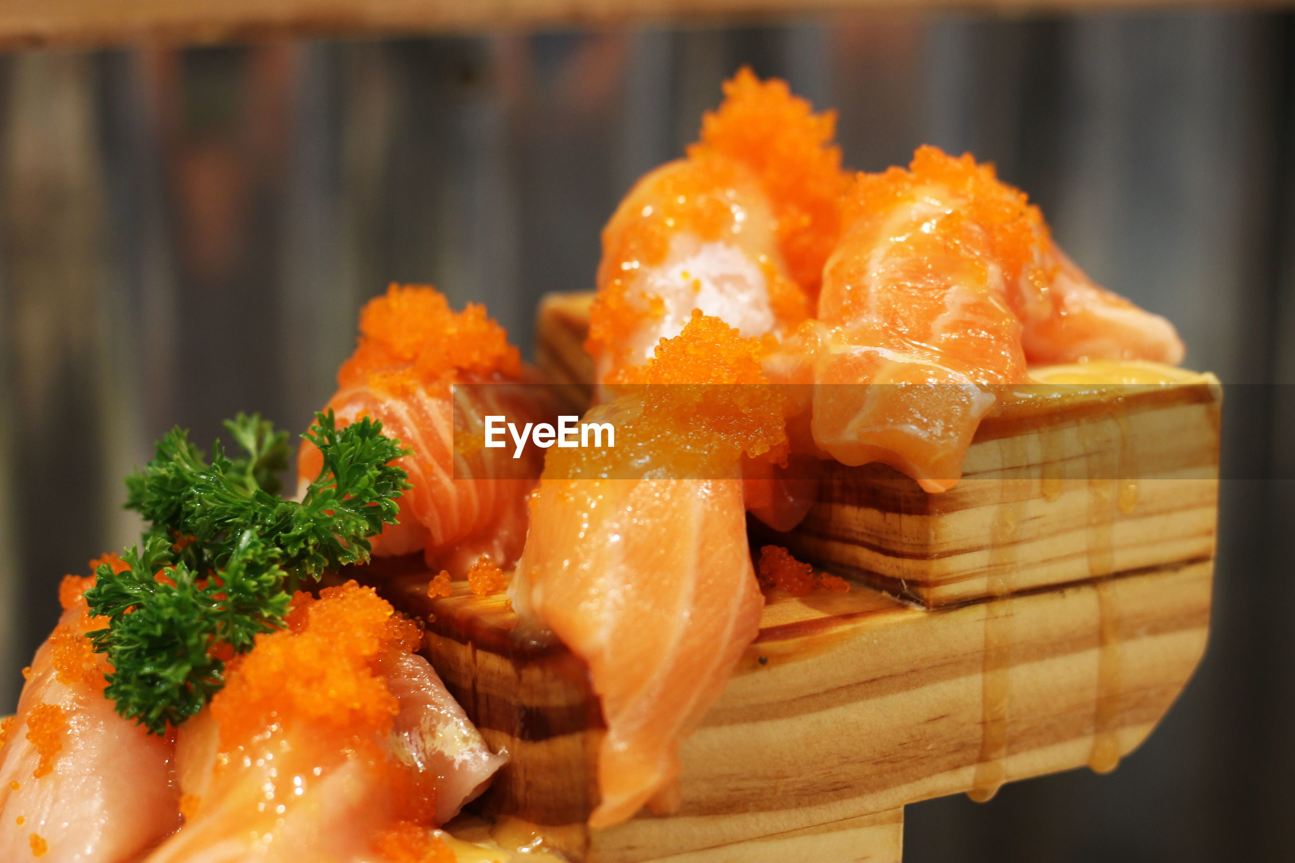 Close-up of salmon sushi served on wood