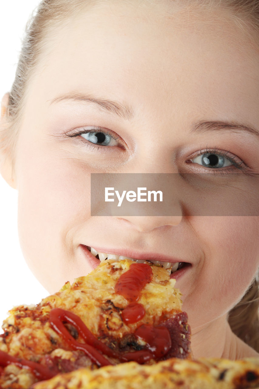 food and drink, close-up, one person, food, portrait, headshot, indoors, child, lifestyles, eating, front view, unhealthy eating, boys, white background, real people, childhood, human body part, ready-to-eat, teenager, pizza, human face, adolescence, temptation, mouth open, hungry, pre-adolescent child, snack