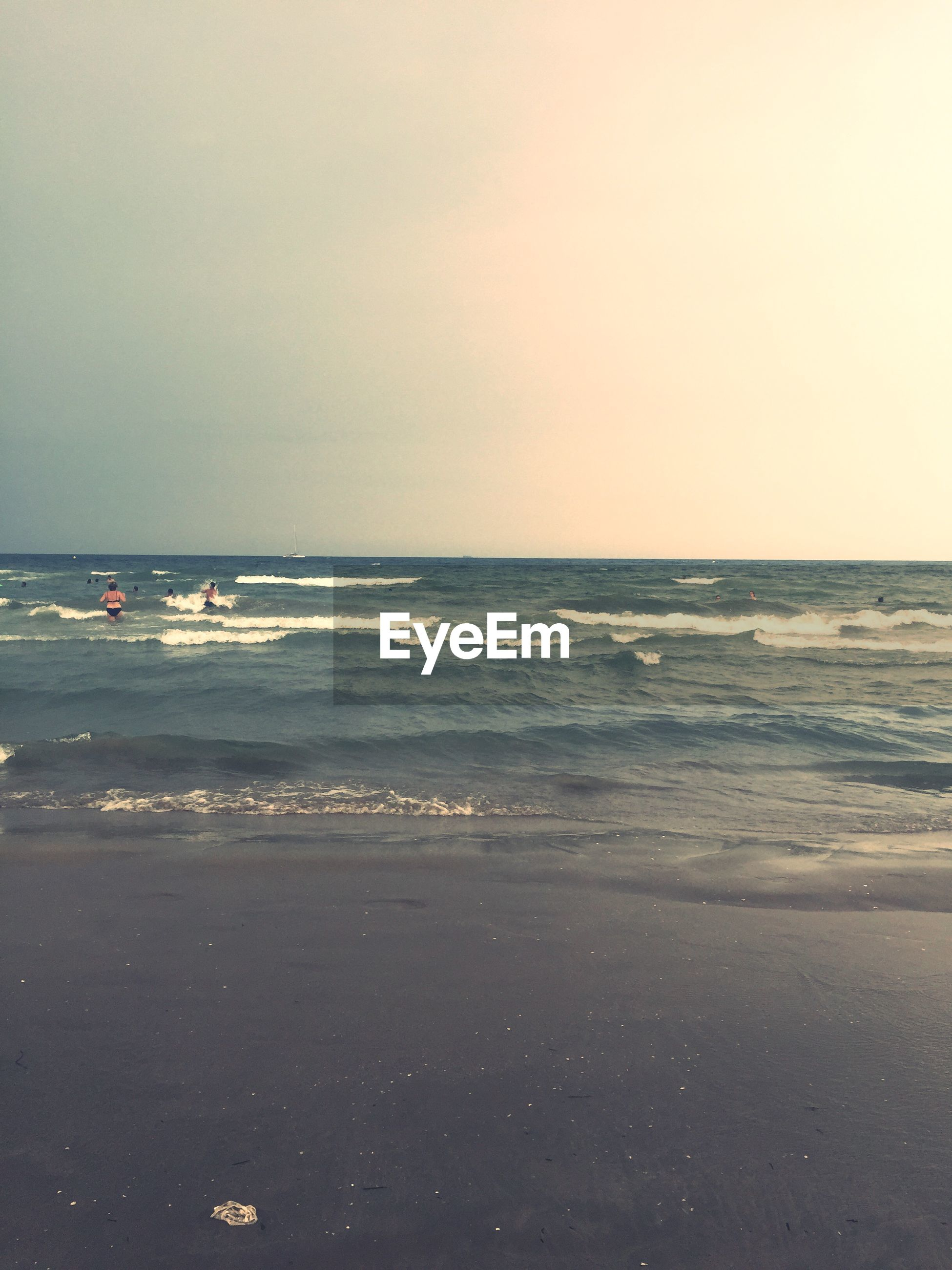 sea, horizon over water, beach, water, shore, scenics, tranquil scene, beauty in nature, tranquility, wave, sand, sky, nature, copy space, clear sky, idyllic, incidental people, surf, coastline, nautical vessel