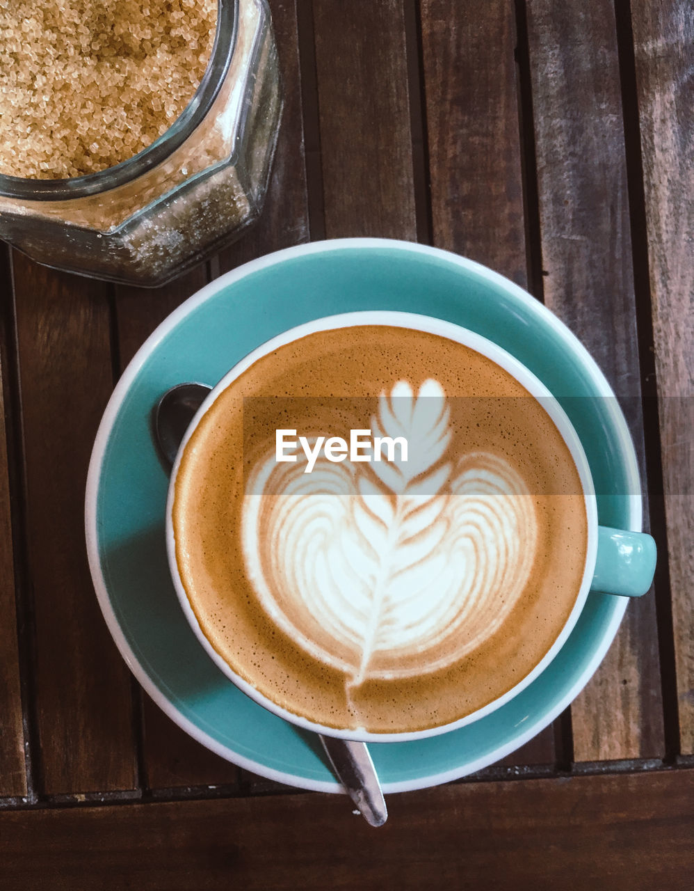 drink, food and drink, cup, refreshment, coffee - drink, frothy drink, coffee, coffee cup, table, mug, still life, hot drink, cappuccino, froth art, crockery, saucer, wood - material, freshness, food, directly above, no people, latte, non-alcoholic beverage, breakfast