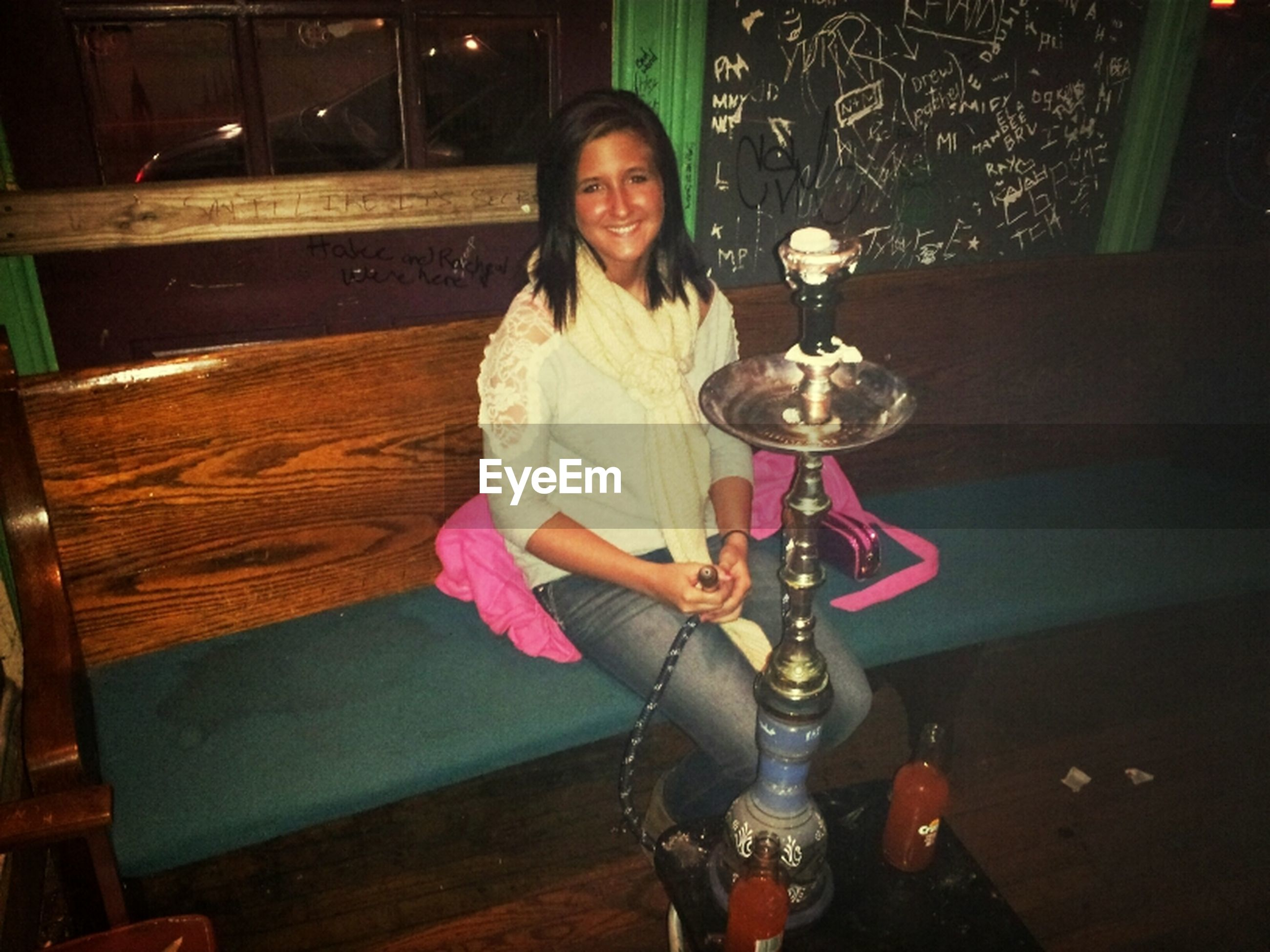 lifestyles, person, indoors, casual clothing, holding, front view, leisure activity, young adult, table, night, looking at camera, portrait, sitting, full length, standing, young women, three quarter length, food and drink