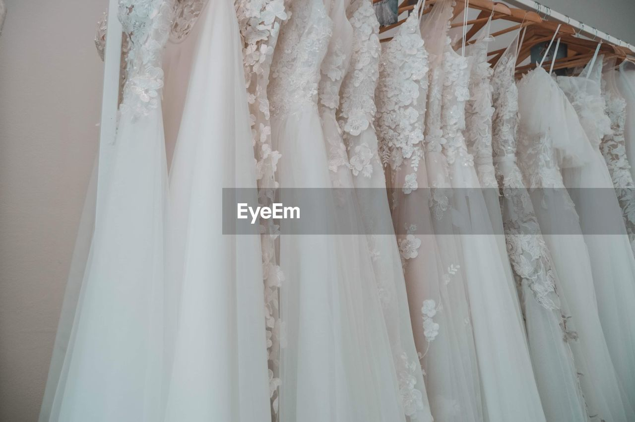 Wedding dresses hanging at store