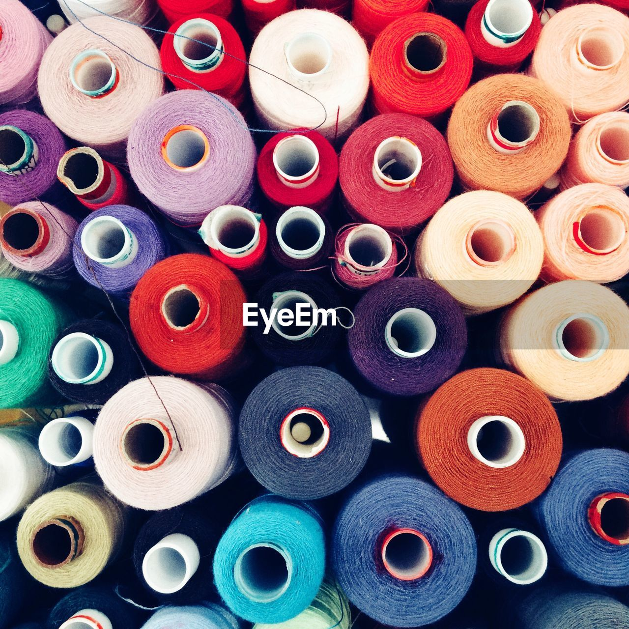 spool, multi colored, sewing item, large group of objects, rolled up, variation, sewing, abundance, cotton, textile industry, full frame, textile, choice, high angle view, no people, indoors, arrangement, retail, day, close-up