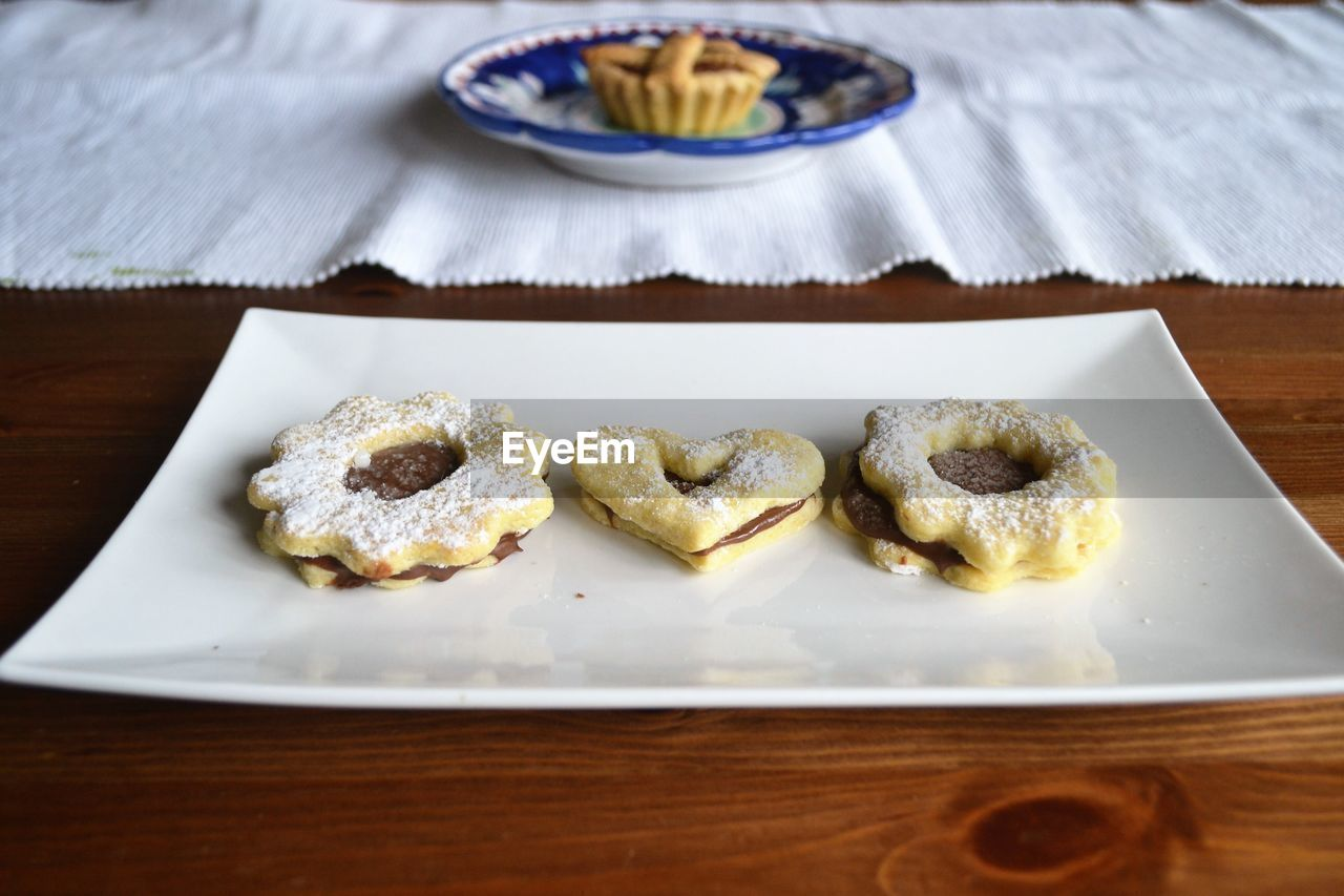 Cookies In Plate On Wooden Table