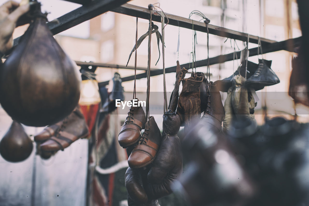 Leather Shoes Hanging In Market Stall