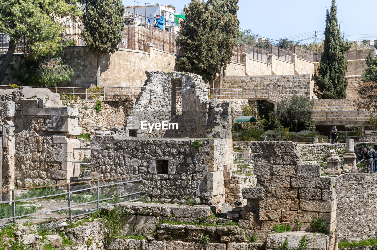 architecture, built structure, history, the past, old ruin, ancient, building exterior, tree, plant, old, travel destinations, nature, no people, solid, day, building, travel, tourism, stone material, wall, ancient civilization, outdoors, archaeology, stone wall, ruined, deterioration