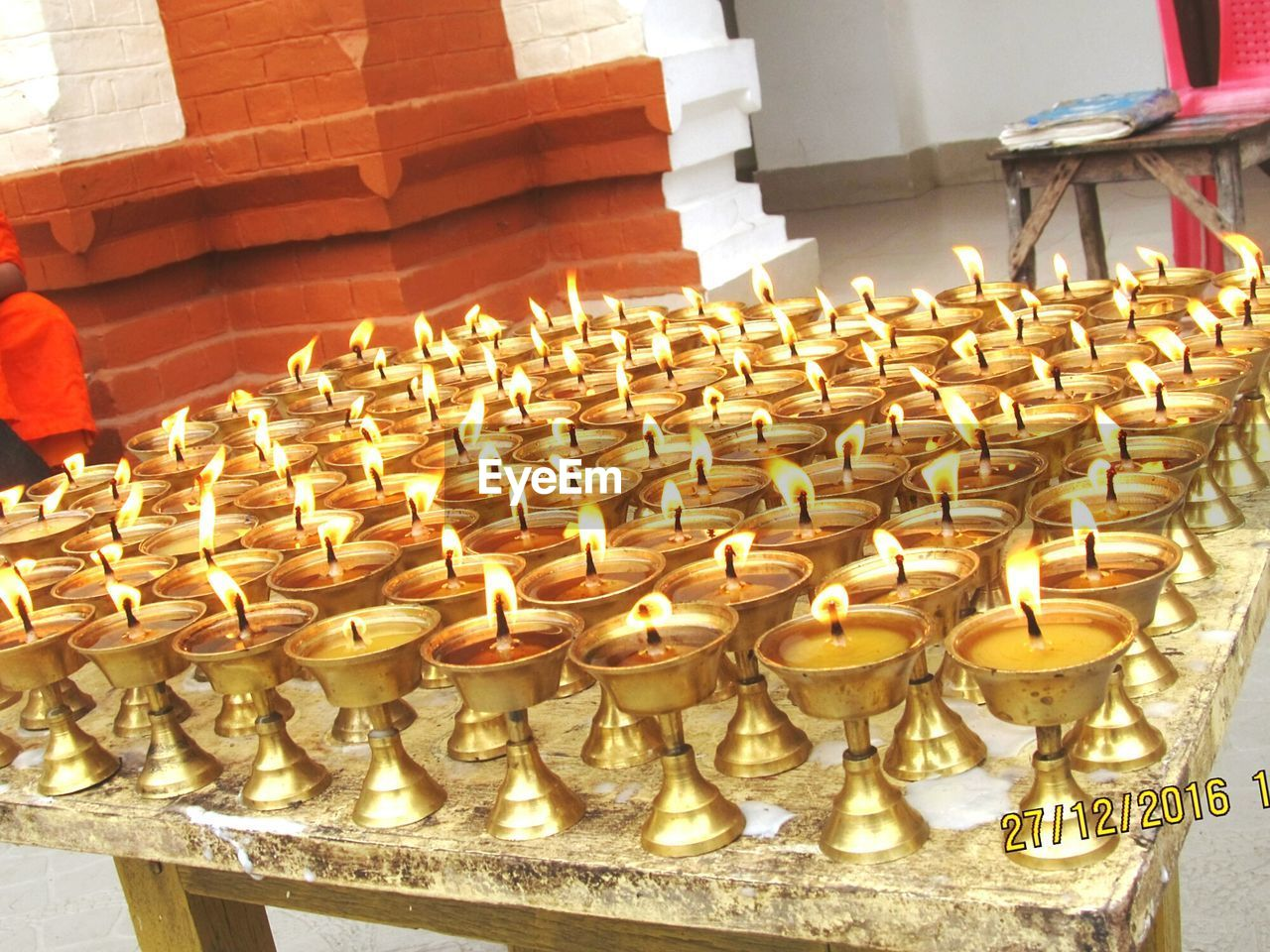 candle, flame, spirituality, religion, burning, place of worship, large group of objects, heat - temperature, no people, indoors, focus on foreground, close-up, day
