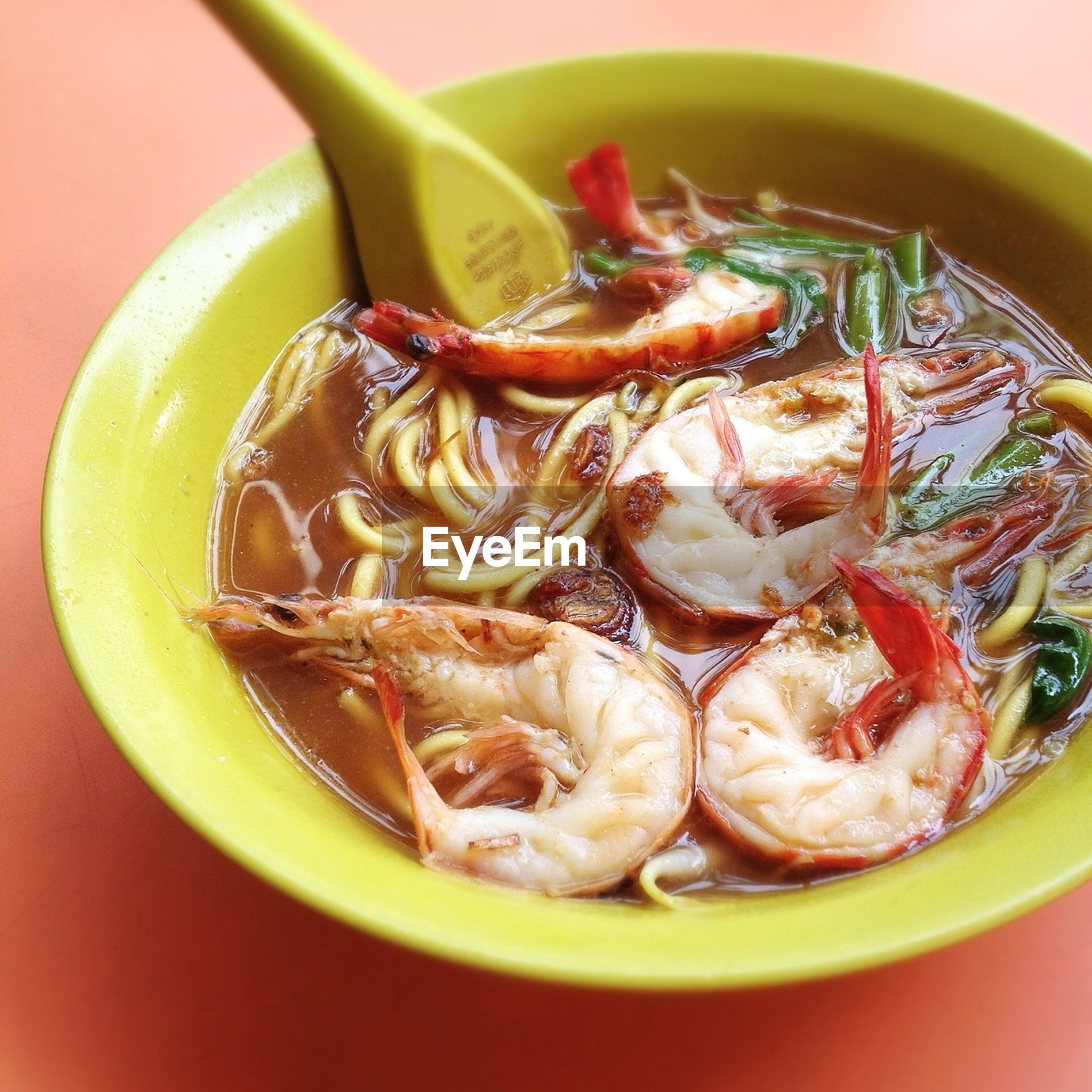 Close up of asian soup with shrimps