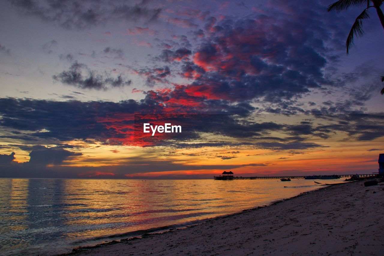 sky, sunset, water, cloud - sky, beauty in nature, scenics - nature, sea, orange color, land, tranquility, tranquil scene, beach, horizon, nature, horizon over water, idyllic, dramatic sky, no people, outdoors
