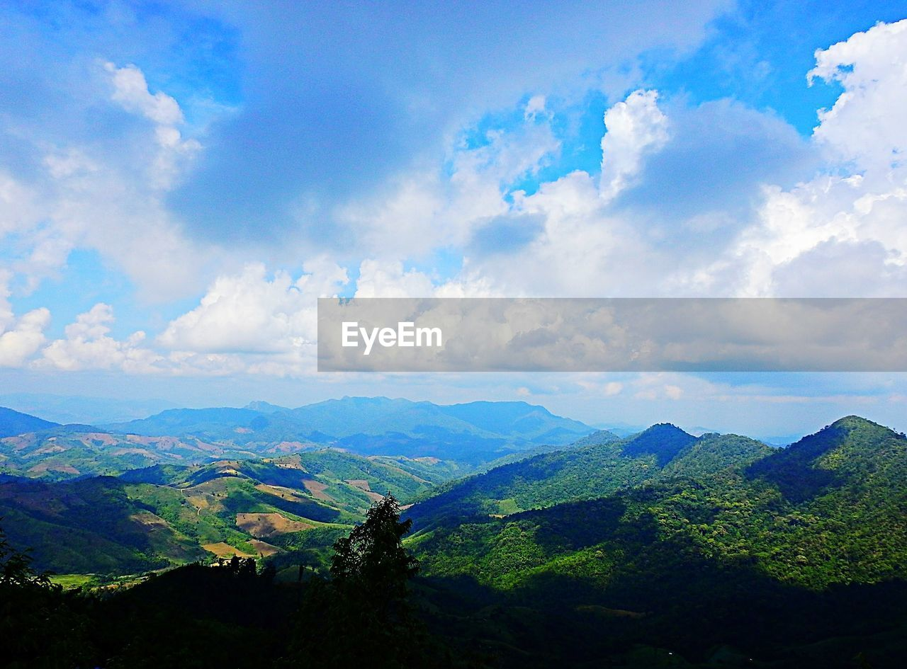 cloud - sky, sky, scenics - nature, beauty in nature, tranquil scene, mountain, tranquility, environment, landscape, non-urban scene, nature, mountain range, idyllic, no people, day, outdoors, tree, land, blue, green color