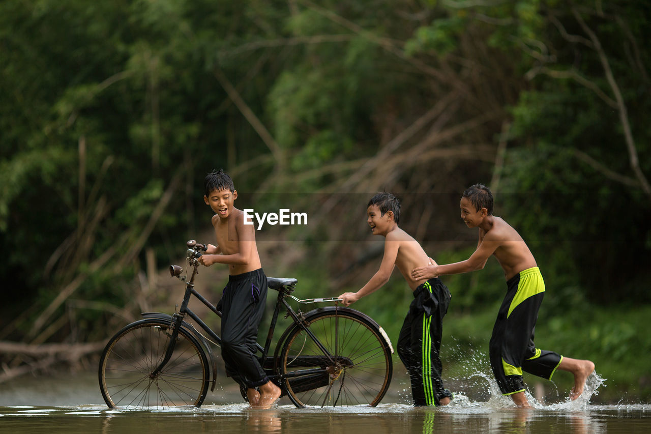 HIGH ANGLE VIEW OF MEN ON BICYCLE