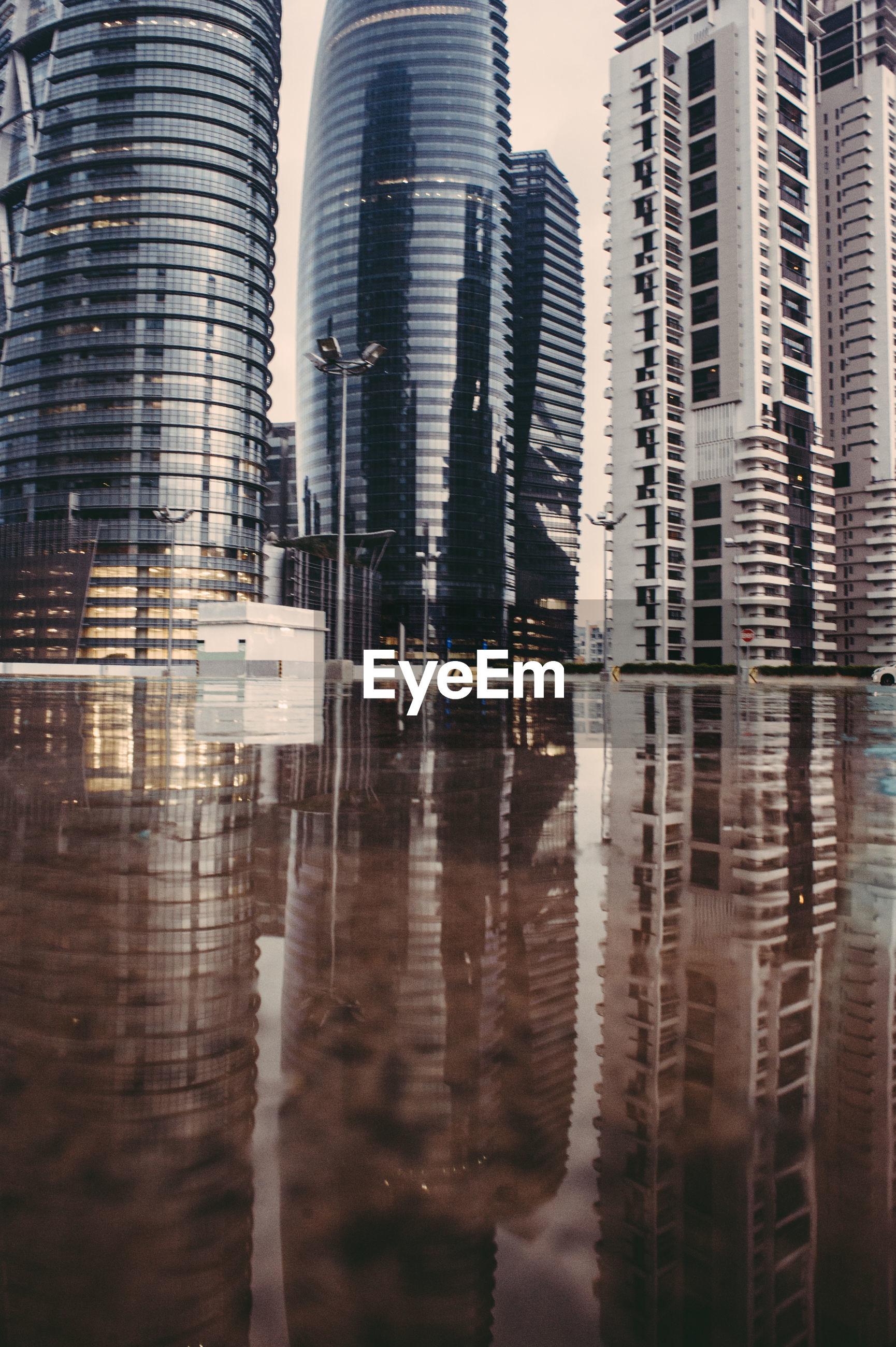 Modern buildings reflecting in water