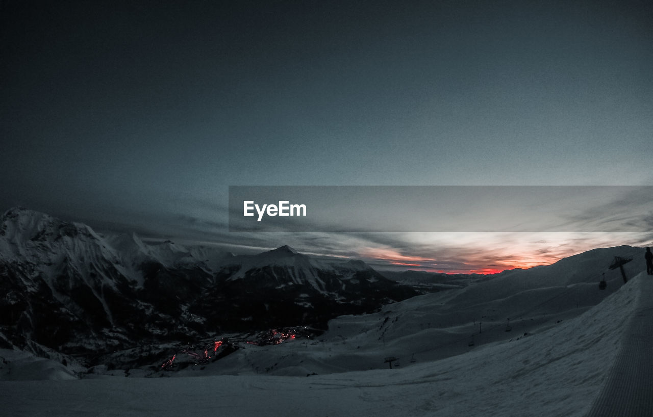 sky, mountain, beauty in nature, scenics - nature, environment, landscape, tranquility, tranquil scene, nature, cloud - sky, snow, winter, non-urban scene, no people, cold temperature, dusk, mountain range, idyllic, outdoors, snowcapped mountain, mountain peak