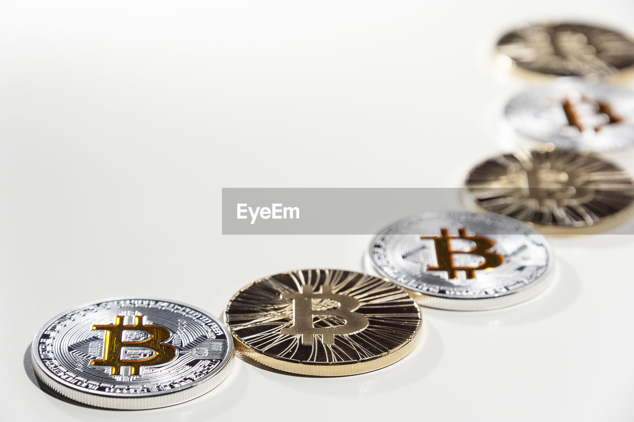 Close-up of bitcoins over white background