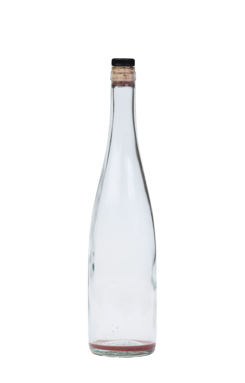 Close-up of empty bottle against white background