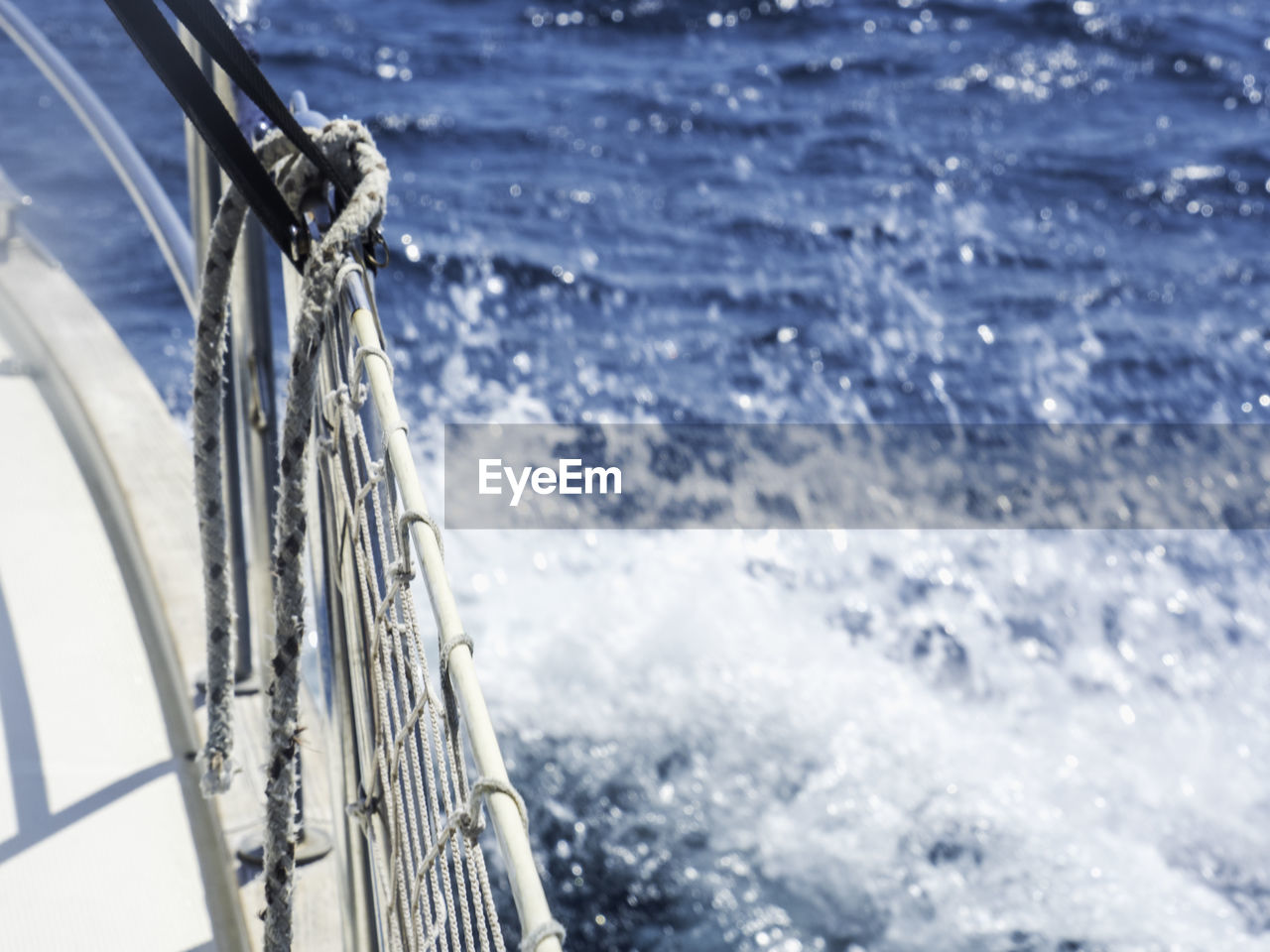 motion, sea, water, sport, transportation, no people, day, nature, nautical vessel, wave, mode of transportation, sailing, aquatic sport, outdoors, railing, focus on foreground, beauty in nature, speed, travel, sailboat, wheel, flowing water