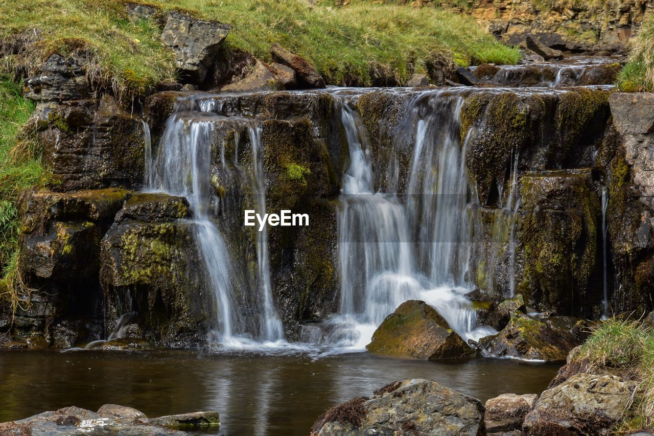 waterfall, water, scenics - nature, motion, beauty in nature, long exposure, flowing water, rock, land, blurred motion, rock - object, no people, nature, environment, solid, forest, day, non-urban scene, outdoors, flowing, power in nature, falling water, rainforest