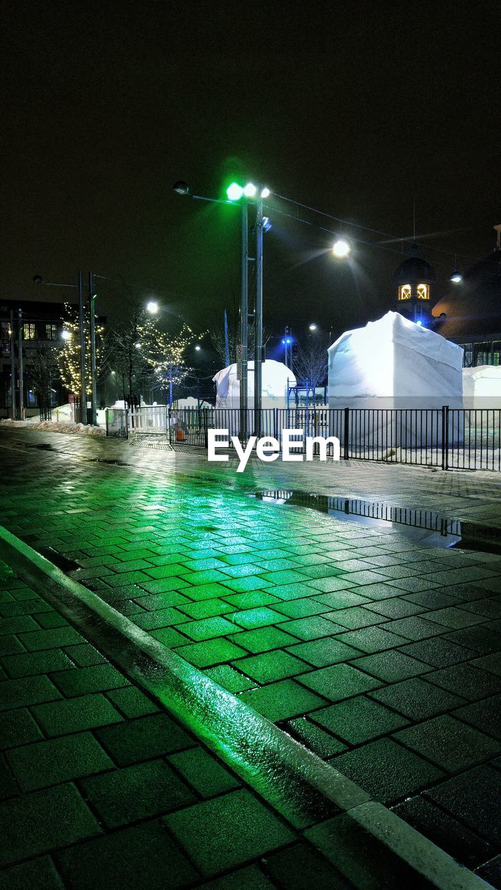 illuminated, night, green color, outdoors, built structure, street light, building exterior, architecture, swimming pool, no people, grass, water, sky