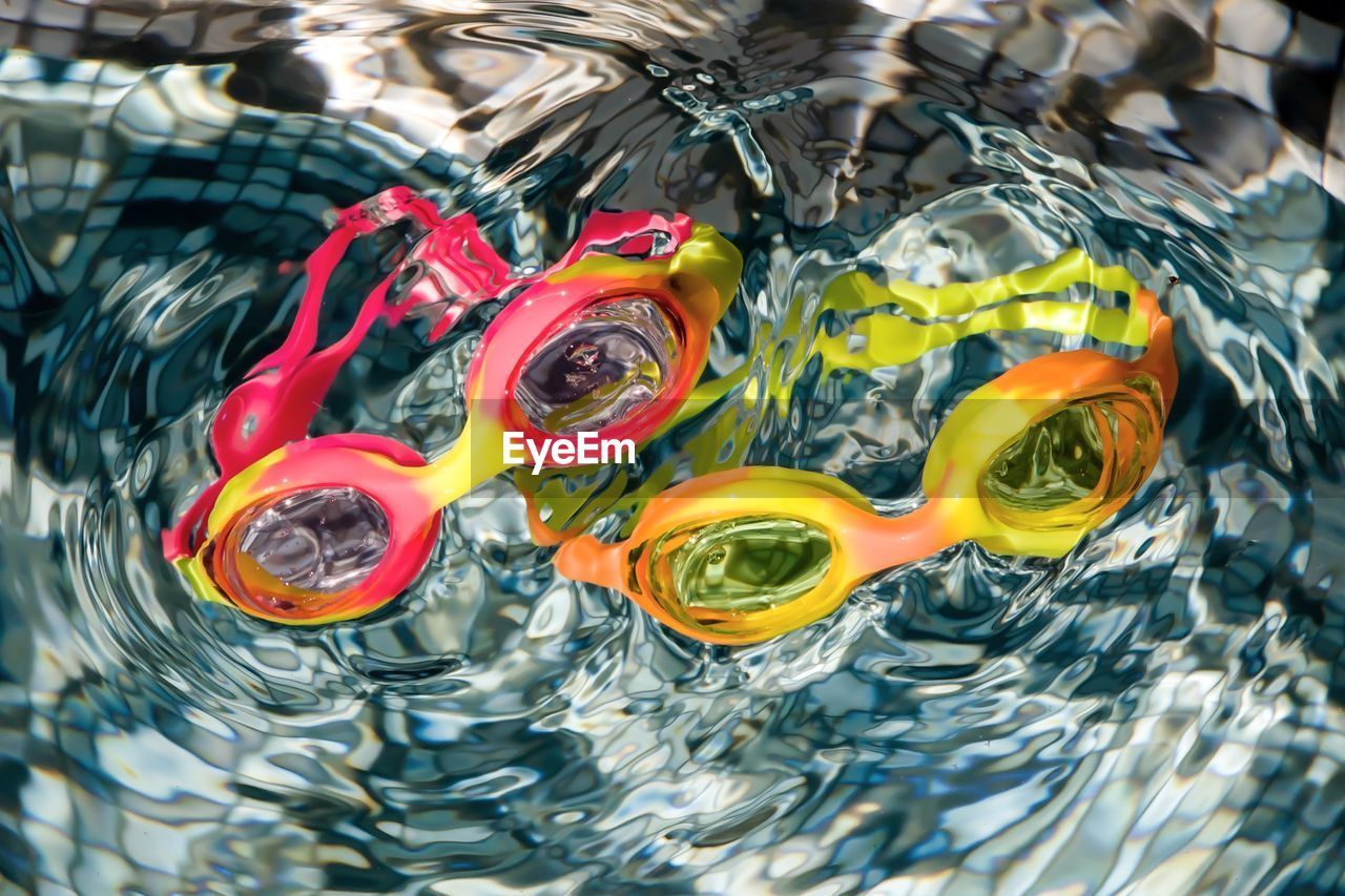 High Angle View Of Swimming Goggles In Pool