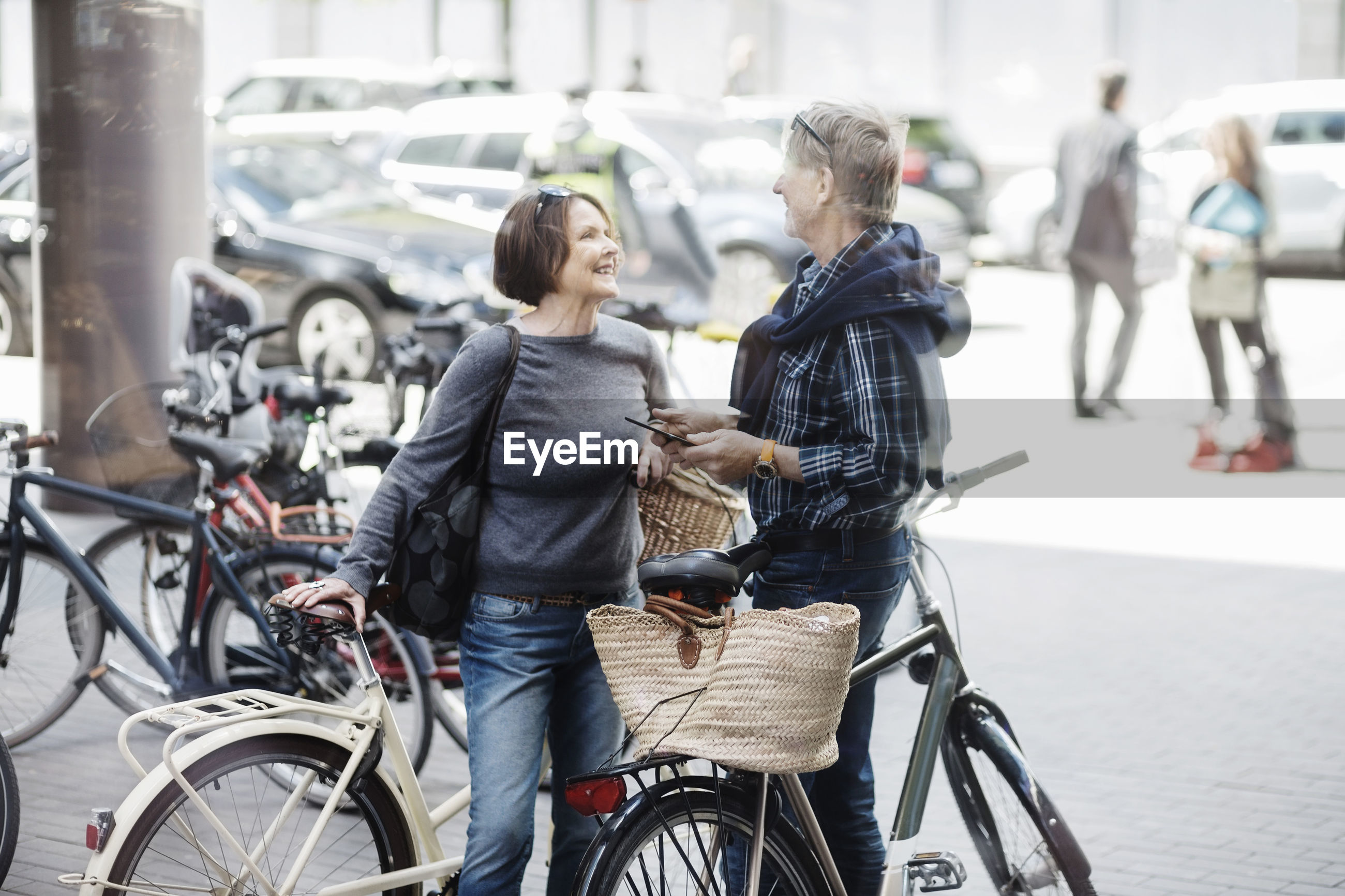 PEOPLE WITH BICYCLE ON STREET