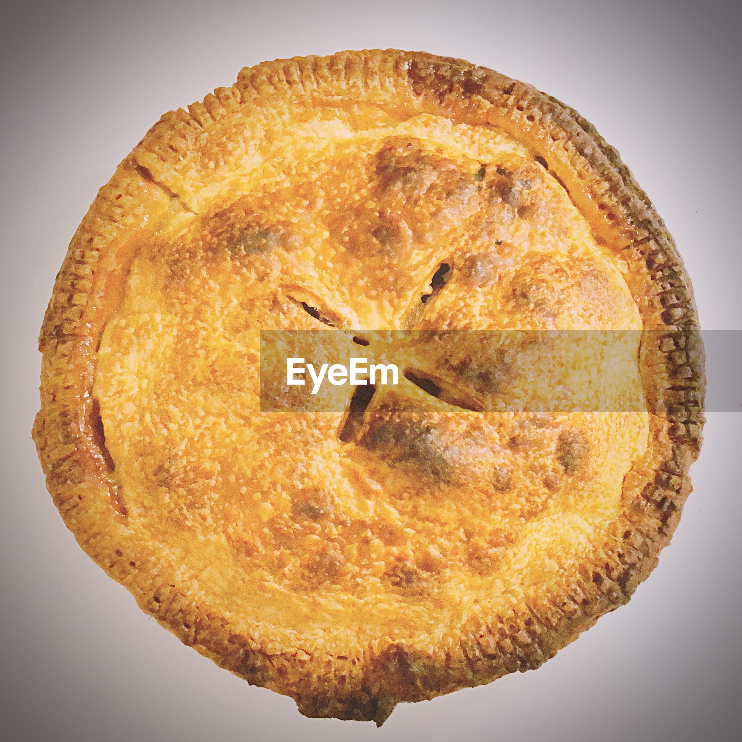 High angle view of sweet pie over white background