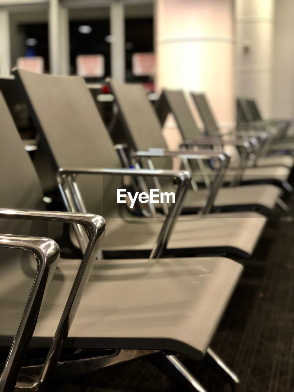 in a row, absence, empty, seat, chair, no people, indoors, metal, focus on foreground, repetition, table, day, still life, selective focus, close-up, silver colored, auditorium, large group of objects, arrangement, relaxation