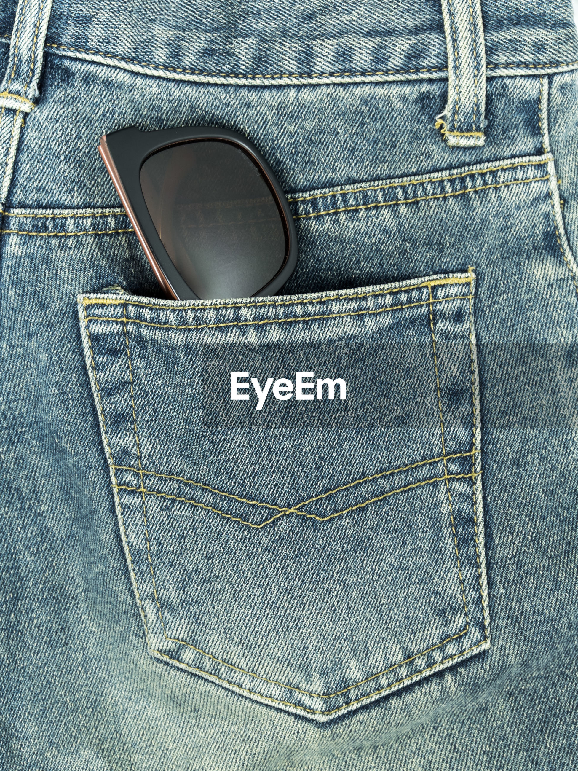 Sunglasses in jeans pocket