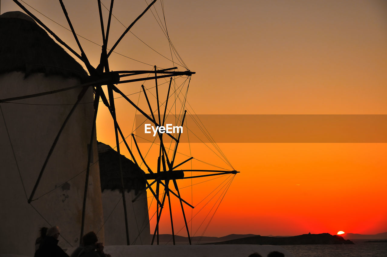sunset, orange color, silhouette, nature, sky, scenics, outdoors, beauty in nature, tranquility, nautical vessel, no people, sea, mast, water, windmill