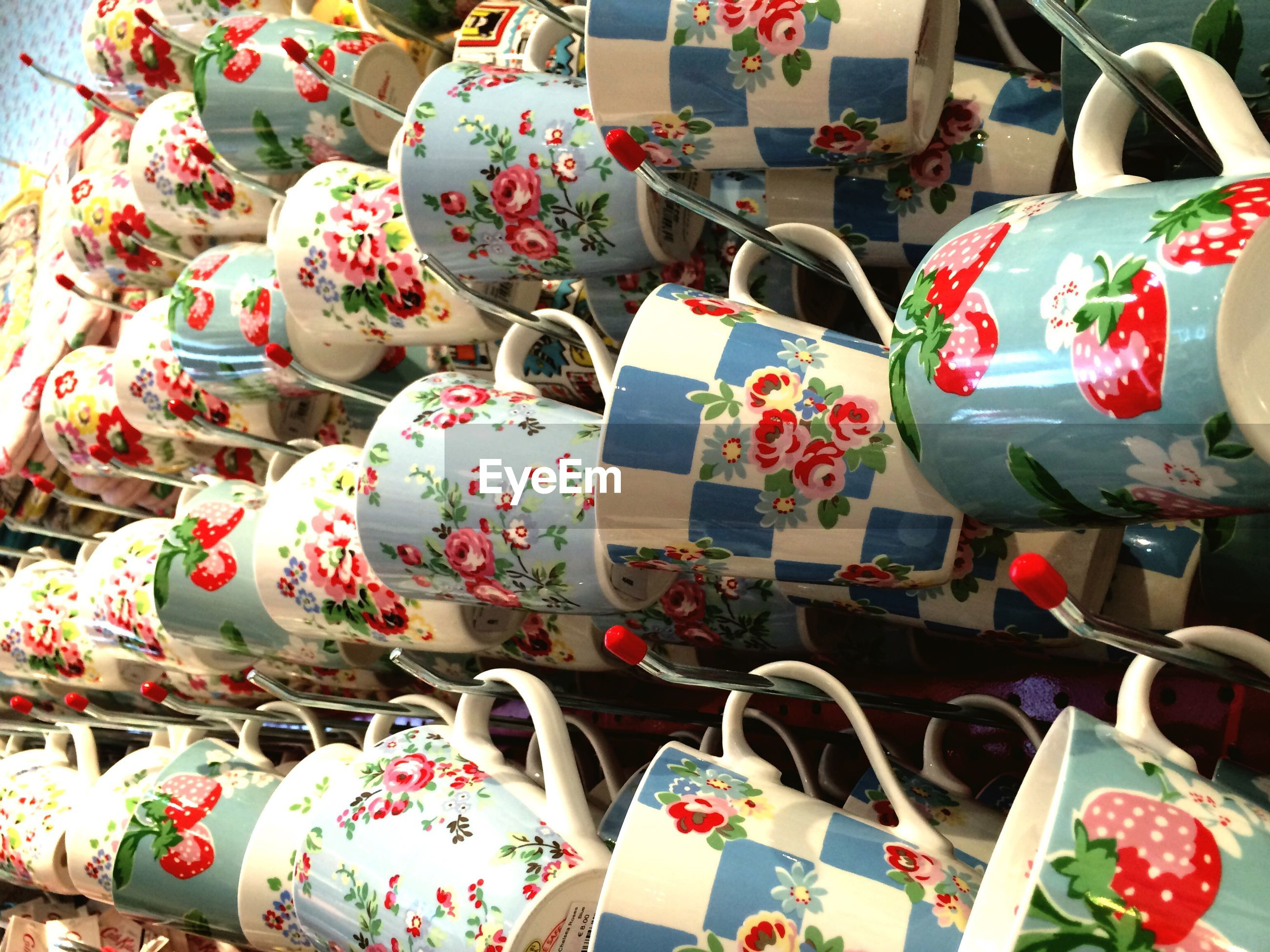 Close-up of cups hanging on hooks