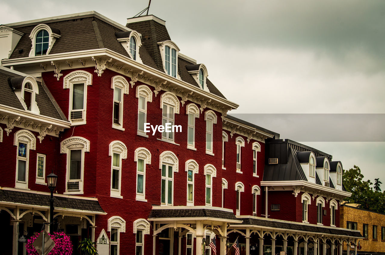 architecture, built structure, building exterior, sky, red, low angle view, cloud - sky, building, no people, nature, day, city, text, outdoors, arch, window, residential district, communication, history, the past