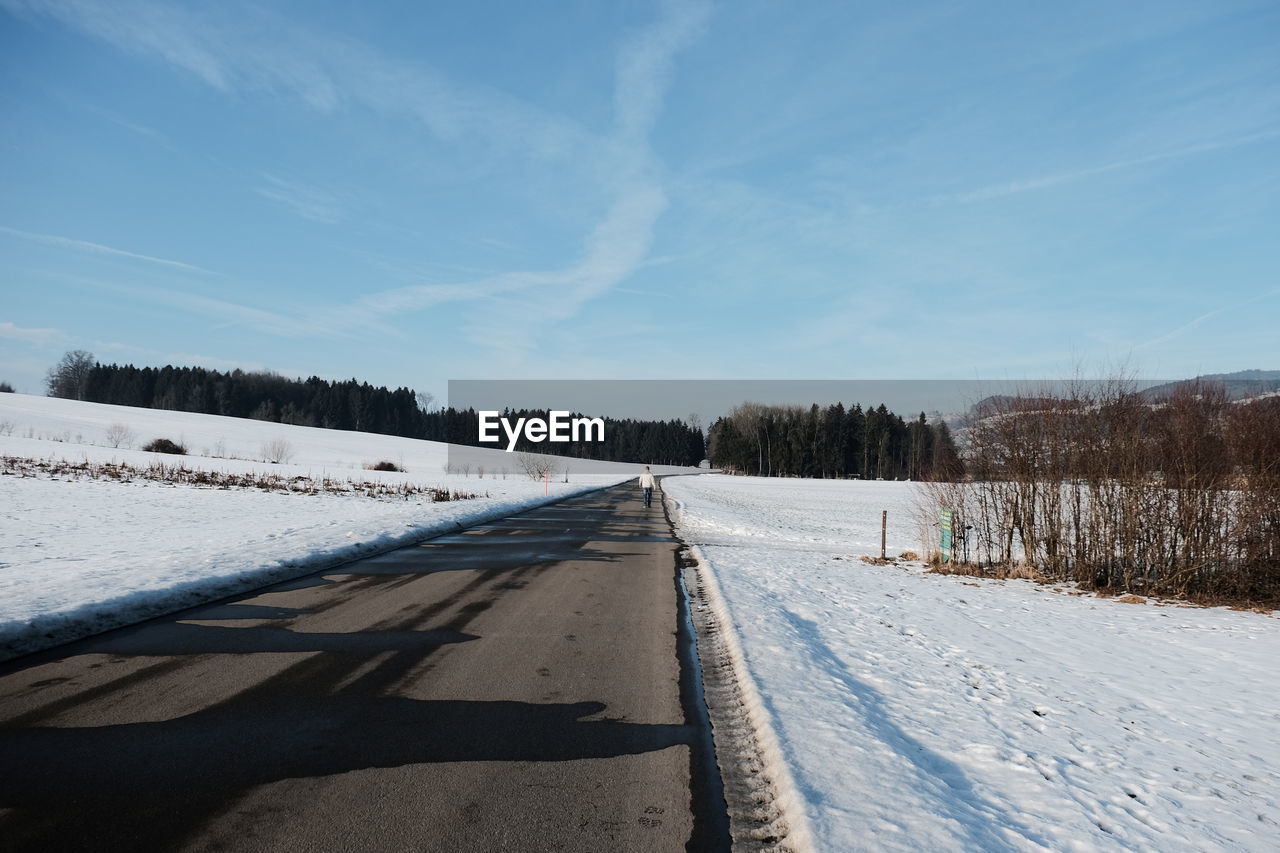 snow, cold temperature, winter, nature, the way forward, scenics, sky, tranquil scene, day, sunlight, tranquility, road, beauty in nature, outdoors, no people, cloud - sky, shadow, transportation, tree, landscape