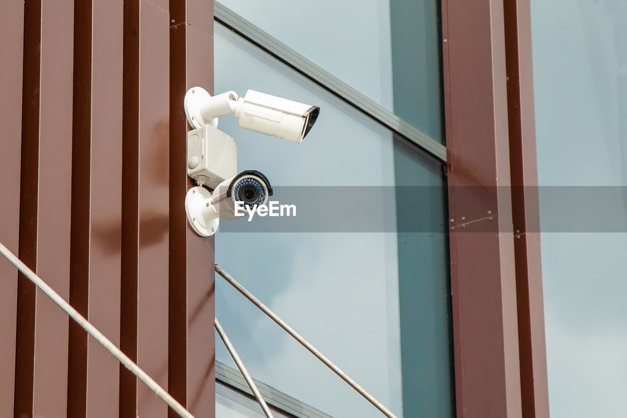Low angle view of security cameras on building