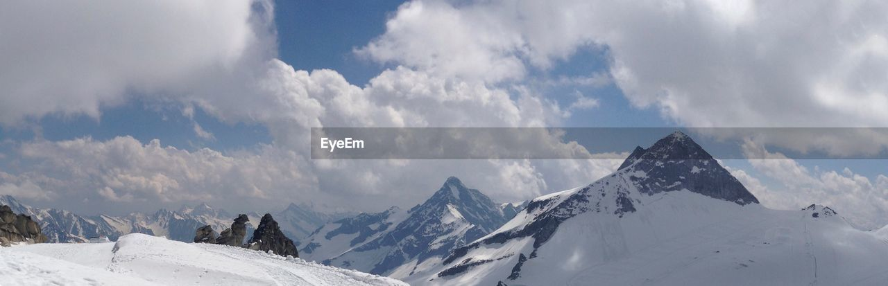 cloud - sky, sky, cold temperature, snow, winter, mountain, beauty in nature, scenics - nature, tranquil scene, tranquility, snowcapped mountain, nature, white color, environment, day, no people, mountain range, landscape, panoramic, mountain peak, range, location, place