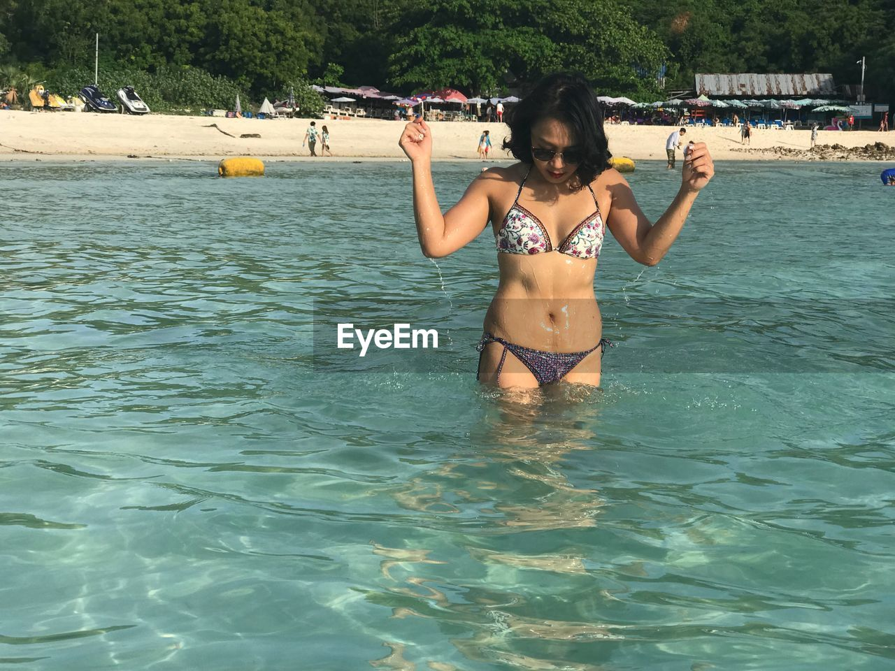 water, real people, leisure activity, one person, lifestyles, swimwear, waterfront, bikini, sea, day, nature, trip, holiday, vacations, sunlight, standing, front view, weekend activities, outdoors, human arm