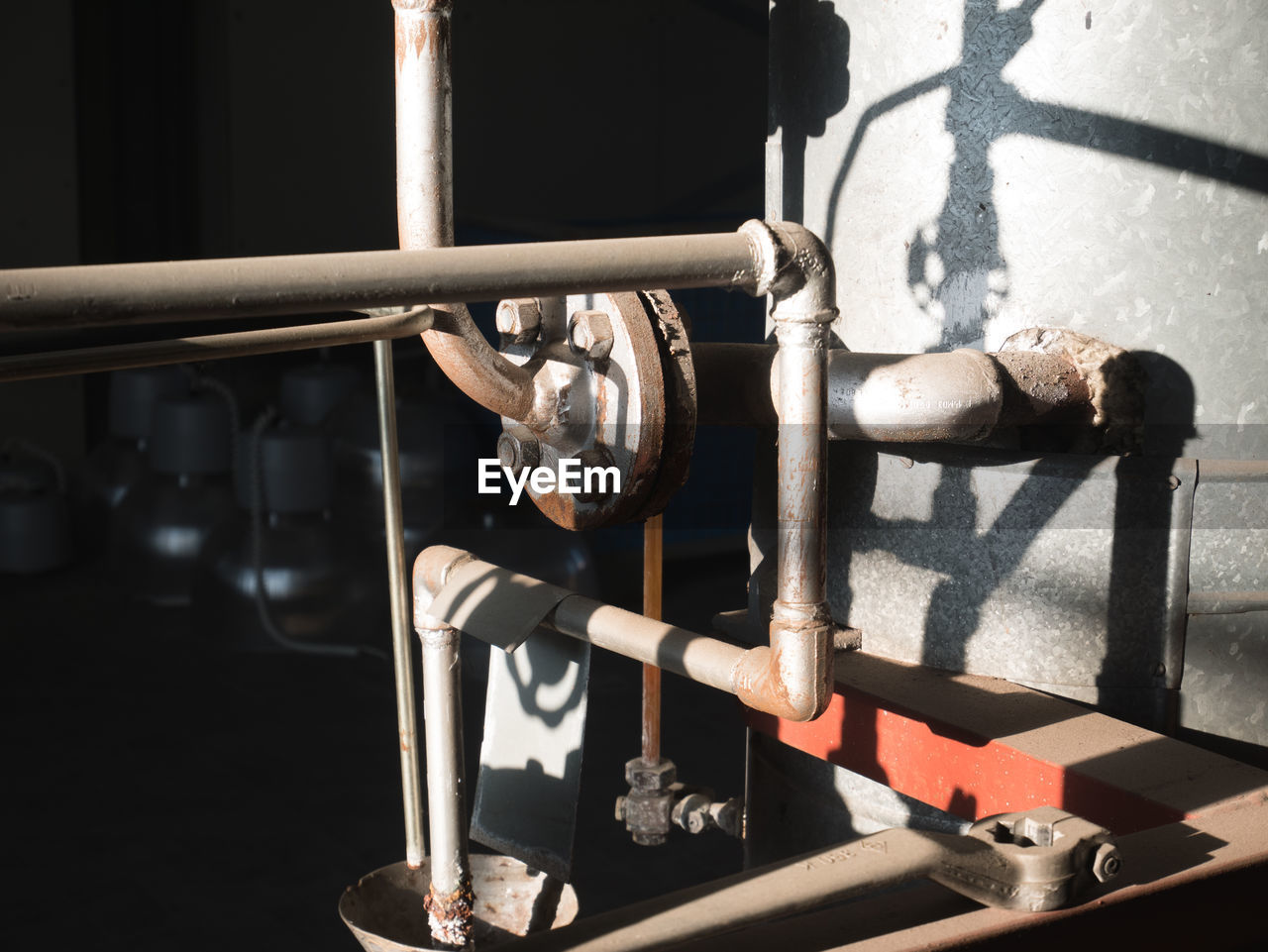 metal, no people, close-up, indoors, equipment, day, sunlight, focus on foreground, old, pipe - tube, factory, machinery, architecture, nature, industry, control, high angle view, valve, machine valve