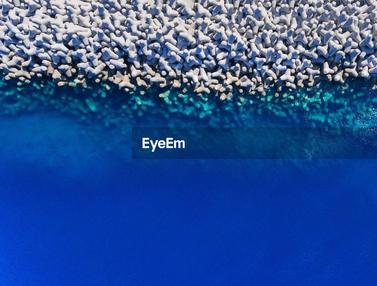 Aerial View Of Tetrapod Rocks By Sea