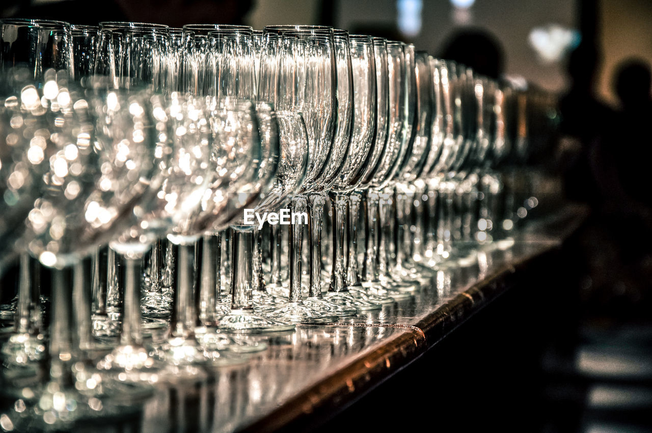 Empty Wineglasses Arranged On Counter In Bar