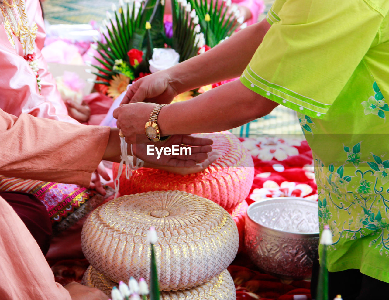 Midsection Of Man Tying Knot Of Couple At Wedding