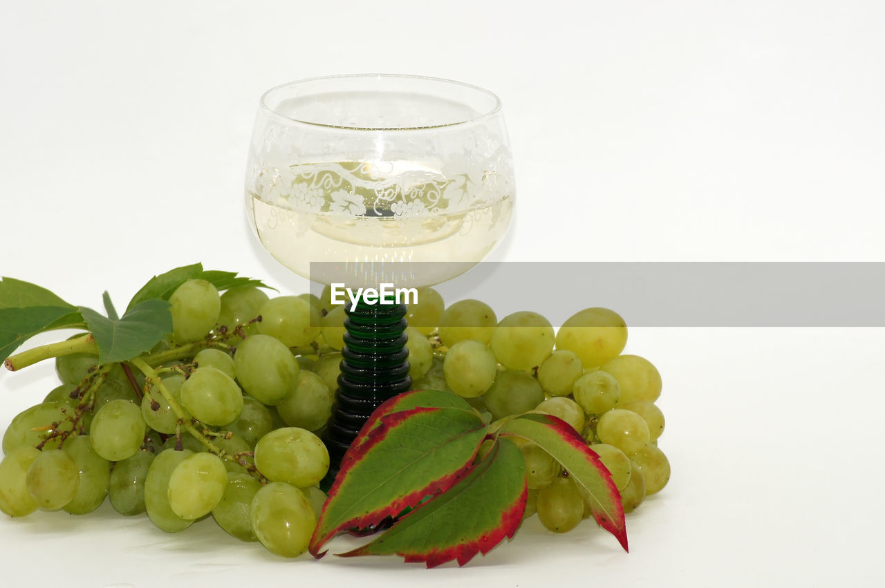 food and drink, food, healthy eating, white background, studio shot, freshness, glass, fruit, still life, wellbeing, green color, indoors, no people, drinking glass, household equipment, copy space, close-up, grape, refreshment, leaf, ripe