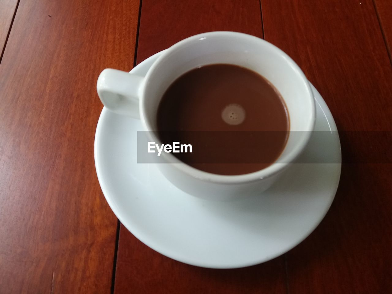 food and drink, drink, refreshment, cup, mug, crockery, saucer, table, coffee, freshness, coffee - drink, coffee cup, indoors, wood - material, high angle view, still life, food, no people, close-up, white color, hot drink, tea cup