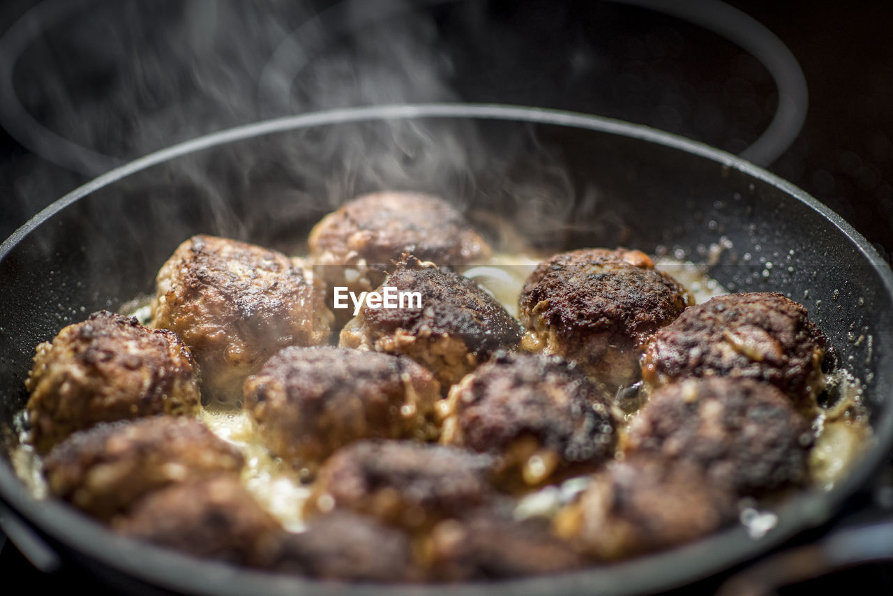 food and drink, food, kitchen utensil, preparation, close-up, freshness, meat, cooking pan, indoors, heat - temperature, household equipment, no people, preparing food, pan, selective focus, smoke - physical structure, still life, ready-to-eat, steam, frying pan, saucepan